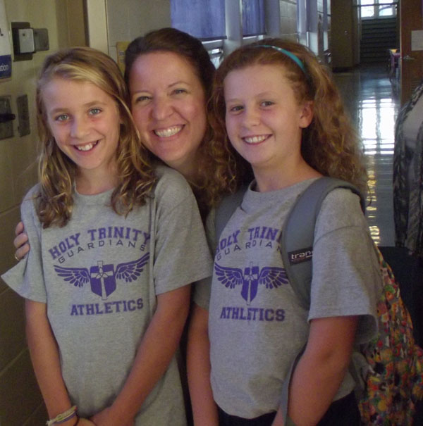 Holy Trinity teacher with two students