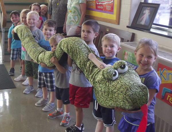 Group Of Holy Trinity Students With Stuffed Dragon